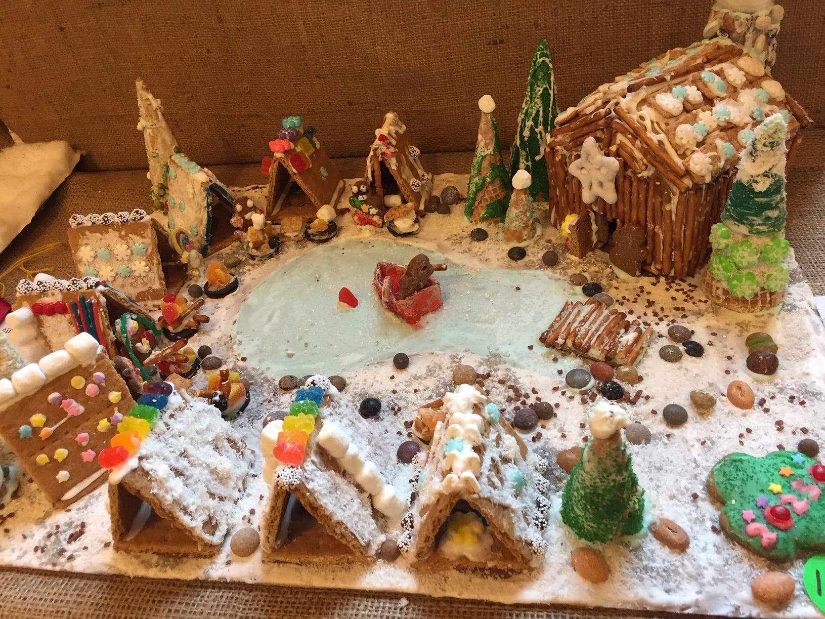 """Merry Camp Site"" by Maplewood Troop 20250, fourth grade, at the 2018 Gingerbread Wonderland at the Frelinghuysen Arboretum. Scout category."