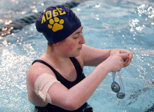 St. Elizabeth senior Madison Schneider, a swimmer with Type 1 diabetes, has a waterproof blood-sugar monitor taped to her arm during practice. November 28, 2018, Florham Park, NJ