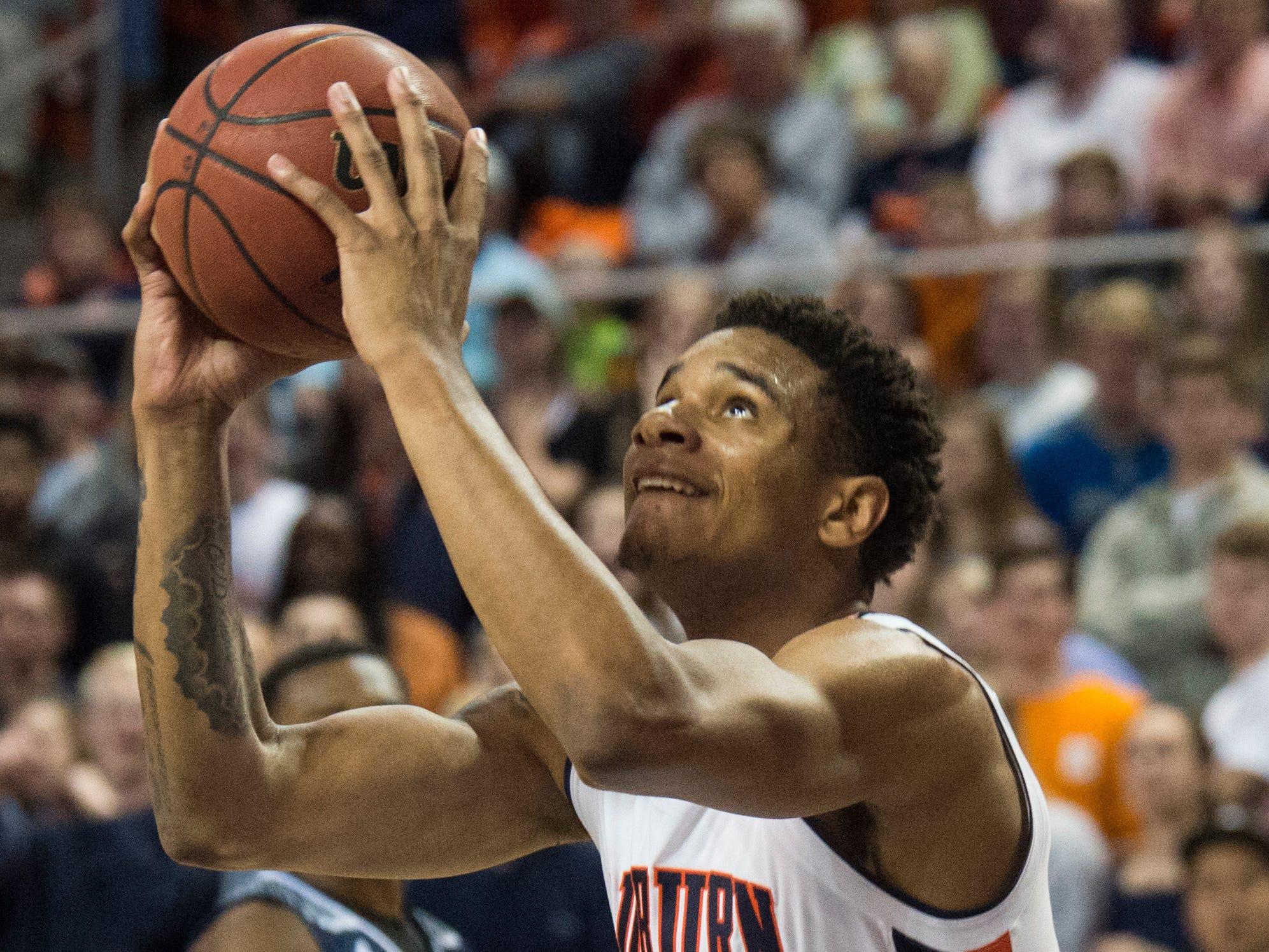 Auburn forward Chuma Okeke (5) goes up for a dunk at Auburn Arena in Auburn, Ala., on Wednesday, Nov. 28, 2018. Auburn defeated Saint Peter's 99-49.