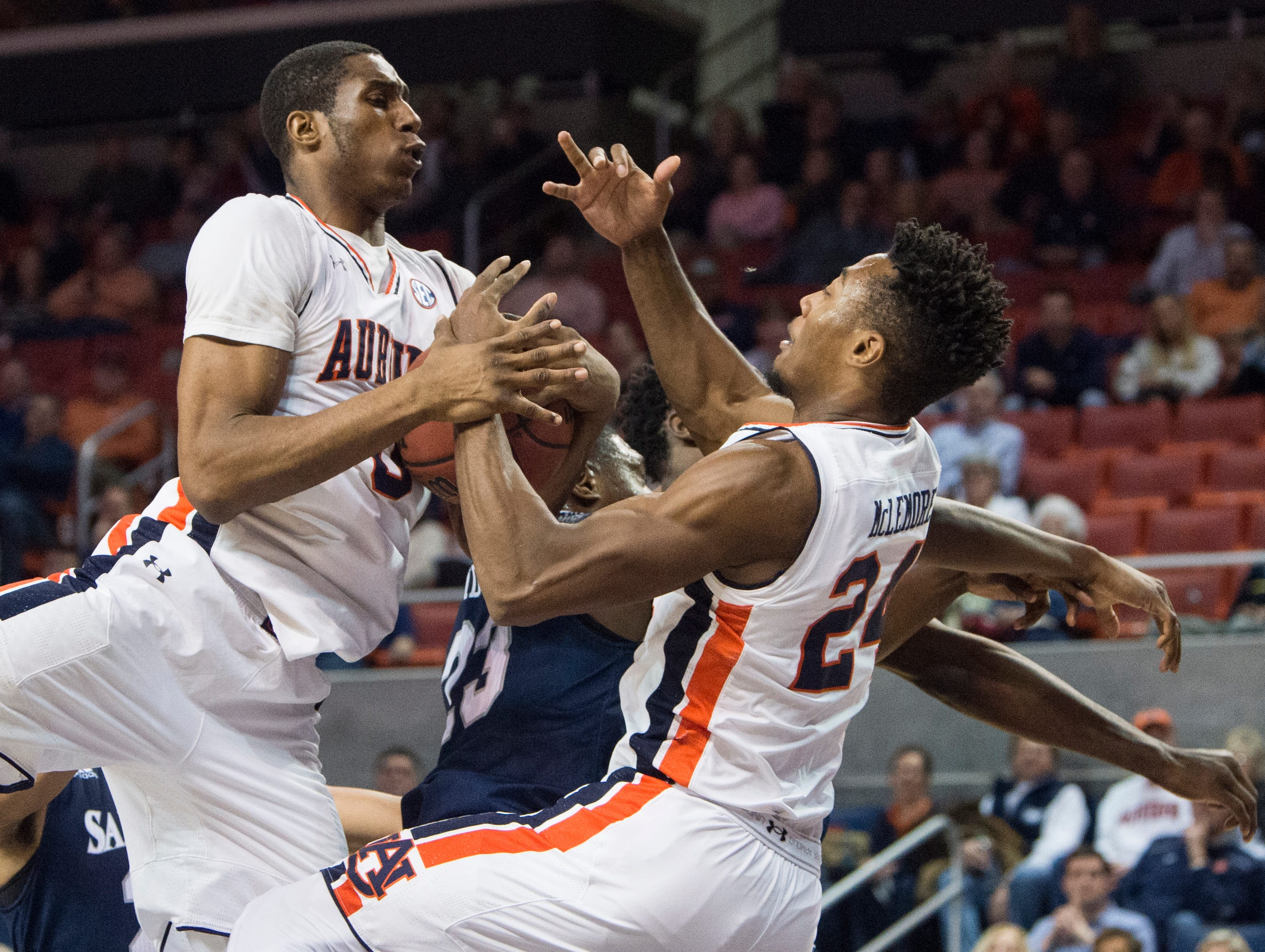 Auburn forward Horace Spencer (0) and forward Anfernee McLemore (24) fight for a rebound at Auburn Arena in Auburn, Ala., on Wednesday, Nov. 28, 2018. Auburn defeated Saint Peter's 99-49.