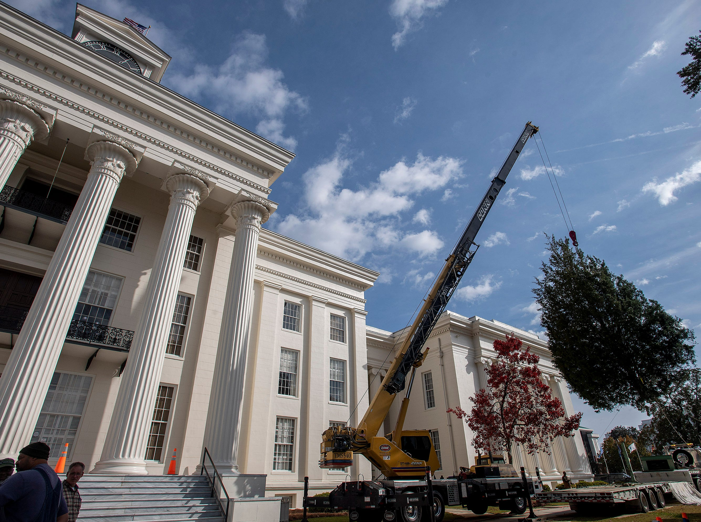 A crane is used to install the State Capitol Christmas Tree on the state capitol steps in Montgomery, Ala., on Thursday November 29, 2018. The tree will be decorated next week and the Tree Lighting will be held on Friday December 7.