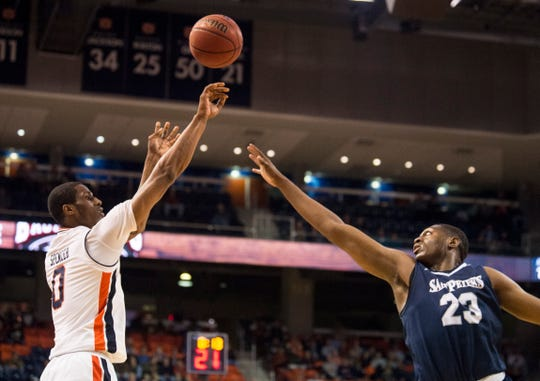 Auburn forward Horace Spencer (0) takes a jump shot over Saint Peter's forward Samuel Idowu (23) at Auburn Arena in Auburn, Ala., on Wednesday, Nov. 28, 2018. Auburn leads Saint Peter's 51-23 at halftime.