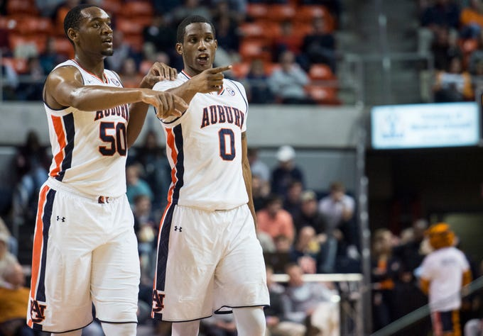 Auburn center Austin Wiley (50) and forward Horace Spencer (0) talk as the come out of a timeout at Auburn Arena in Auburn, Ala., on Wednesday, Nov. 28, 2018. Auburn defeated Saint Peter's 99-49.