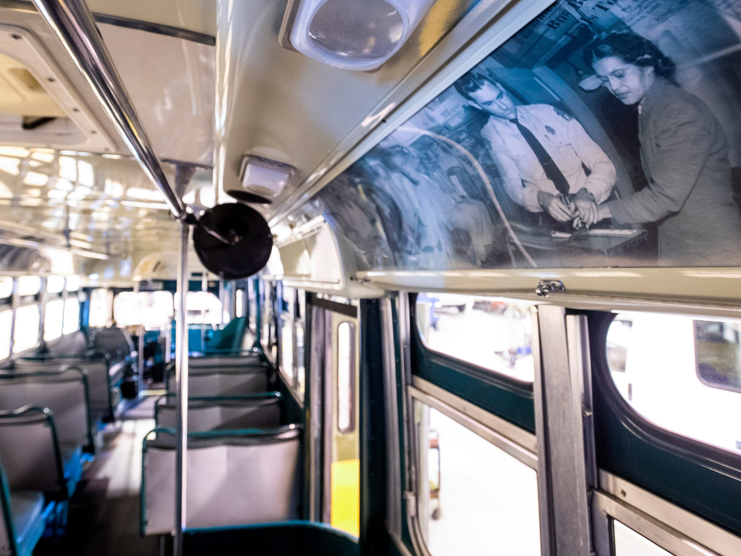 Photographs of Rosa Parks and the Montgomery Bus Boycott line the inside of the historic Cleveland Avenue Bus in Montgomery, Ala., on Thursday November 29, 2018.