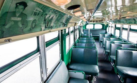 Photographs of Rosa Parks and the Montgomery Bus Boycott line the inside of the Cleveland Avenue Bus in Montgomery, Ala., on Thursday November 29, 2018.