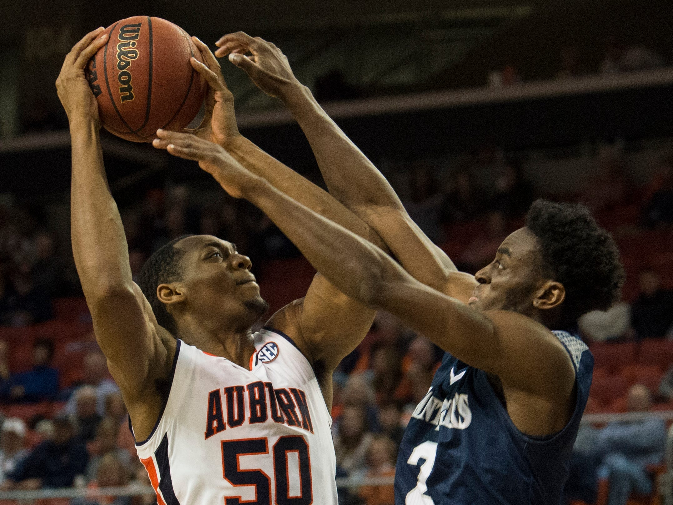 Auburn center Austin Wiley (50) goes up for a layup over Saint Peter's guard Klay Brown (2) at Auburn Arena in Auburn, Ala., on Wednesday, Nov. 28, 2018. Auburn defeated Saint Peter's 99-49.