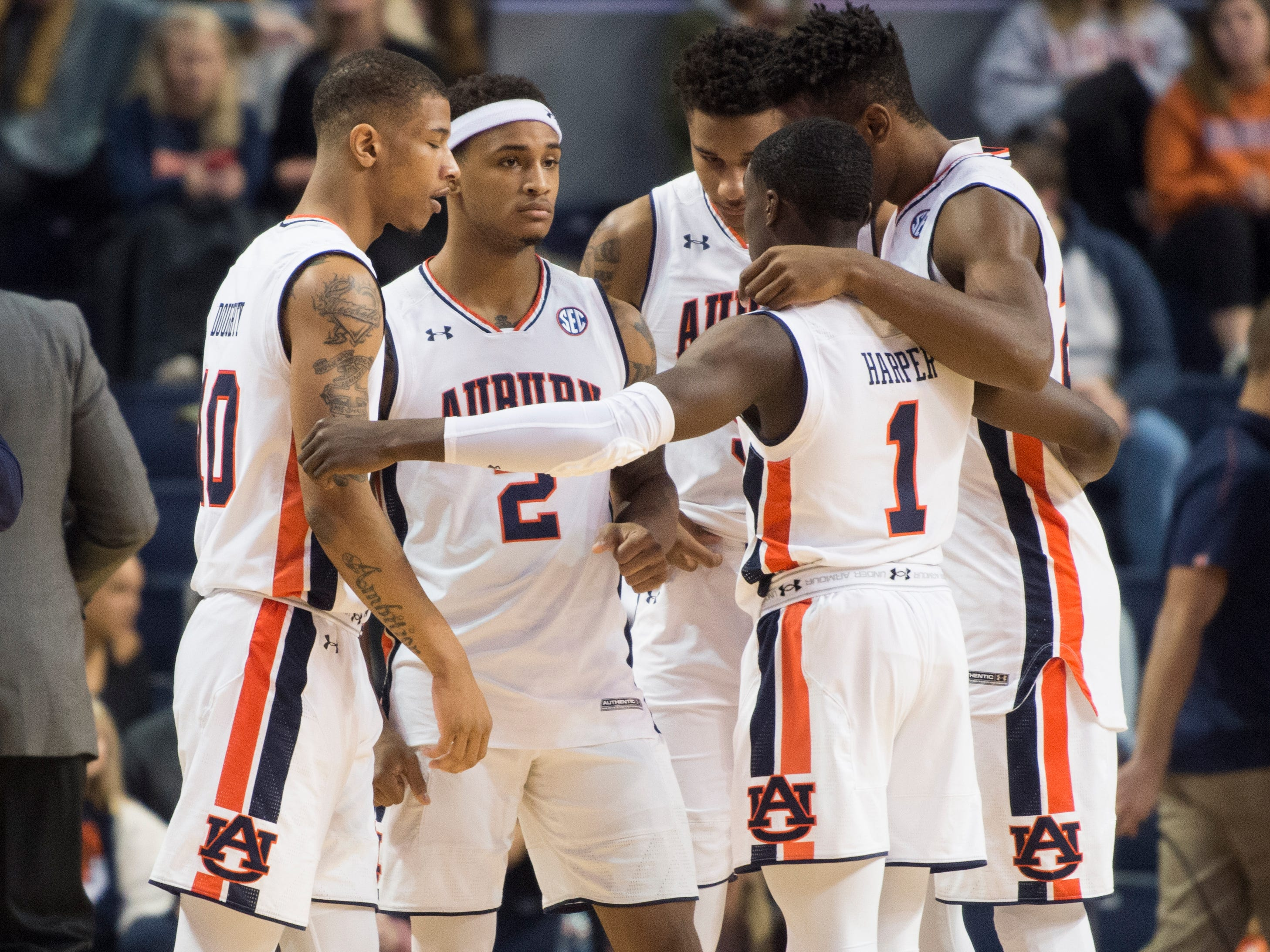 Auburn's starting five huddle up as they take the court at Auburn Arena in Auburn, Ala., on Wednesday, Nov. 28, 2018. Auburn defeated Saint Peter's 99-49.