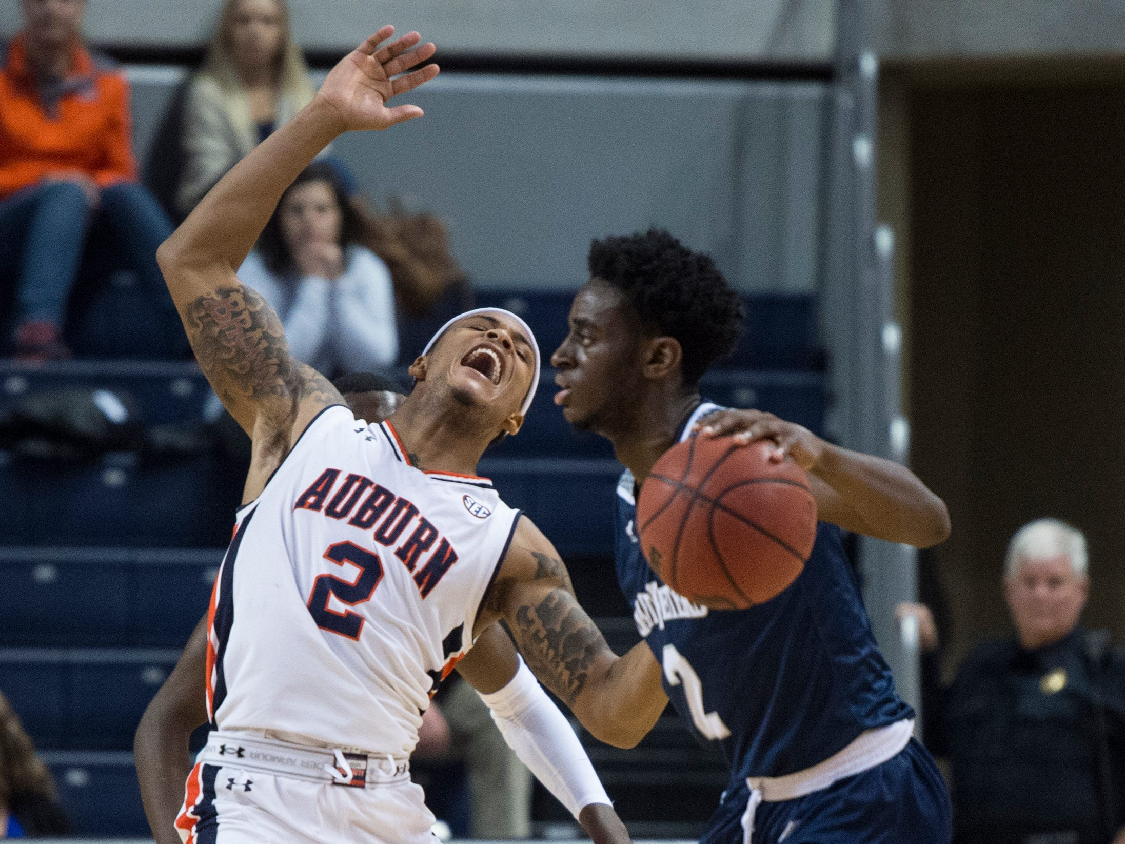 Auburn guard Bryce Brown (2) reacts to a shove off by Saint Peter's guard Klay Brown (2) at Auburn Arena in Auburn, Ala., on Wednesday, Nov. 28, 2018. Auburn defeated Saint Peter's 99-49.