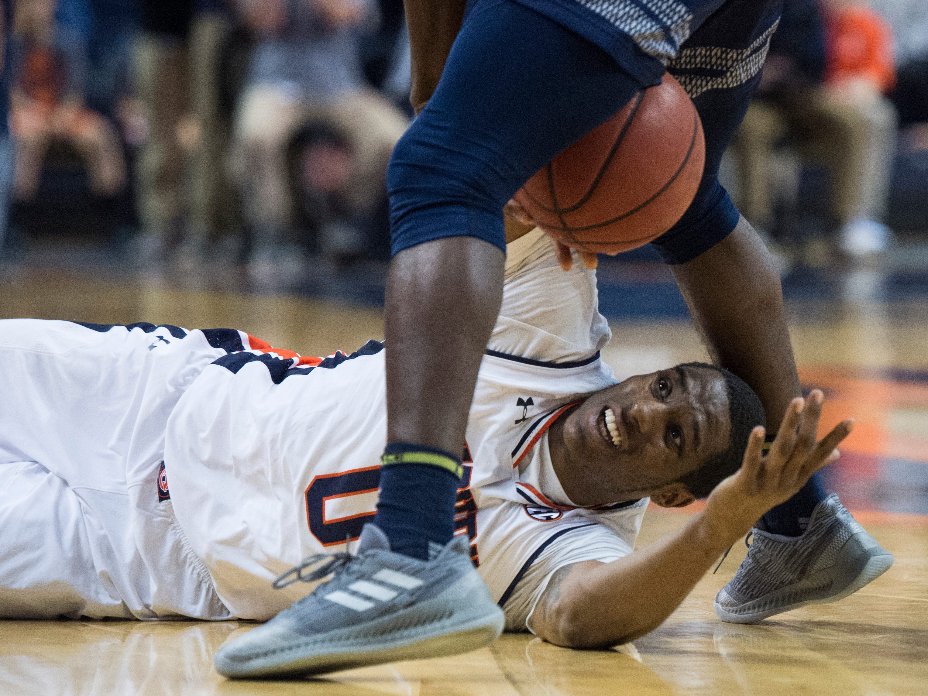 Auburn forward Horace Spencer (0) fights for a loose ball at Auburn Arena in Auburn, Ala., on Wednesday, Nov. 28, 2018. Auburn defeated Saint Peter's 99-49.