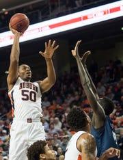 Auburn center Austin Wiley (50) goes up for a post shot at Auburn Arena in Auburn, Ala., on Wednesday, Nov. 28, 2018. Auburn defeated Saint Peter's 99-49.