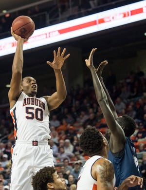 Auburn center Austin Wiley (50) goes up for a post shot at Auburn Arena in Auburn, Ala., on Wednesday, Nov. 28, 2018. Auburn defeated Saint Peter's 99-49.