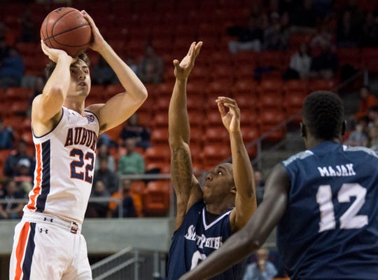 Auburn guard Will Macoy (22) attempts a jump shot at Auburn Arena in Auburn, Ala., on Wednesday, Nov. 28, 2018. Auburn defeated Saint Peter's 99-49.
