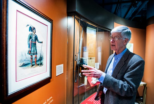 Ed Bridges, retired Director of the Alabama Department of Archives and History, still goes to the Archives to work most days. Bridges points out a print of Seminole leader Osceola at the archives building in Montgomery, Ala., on Wednesday November 28, 2018.