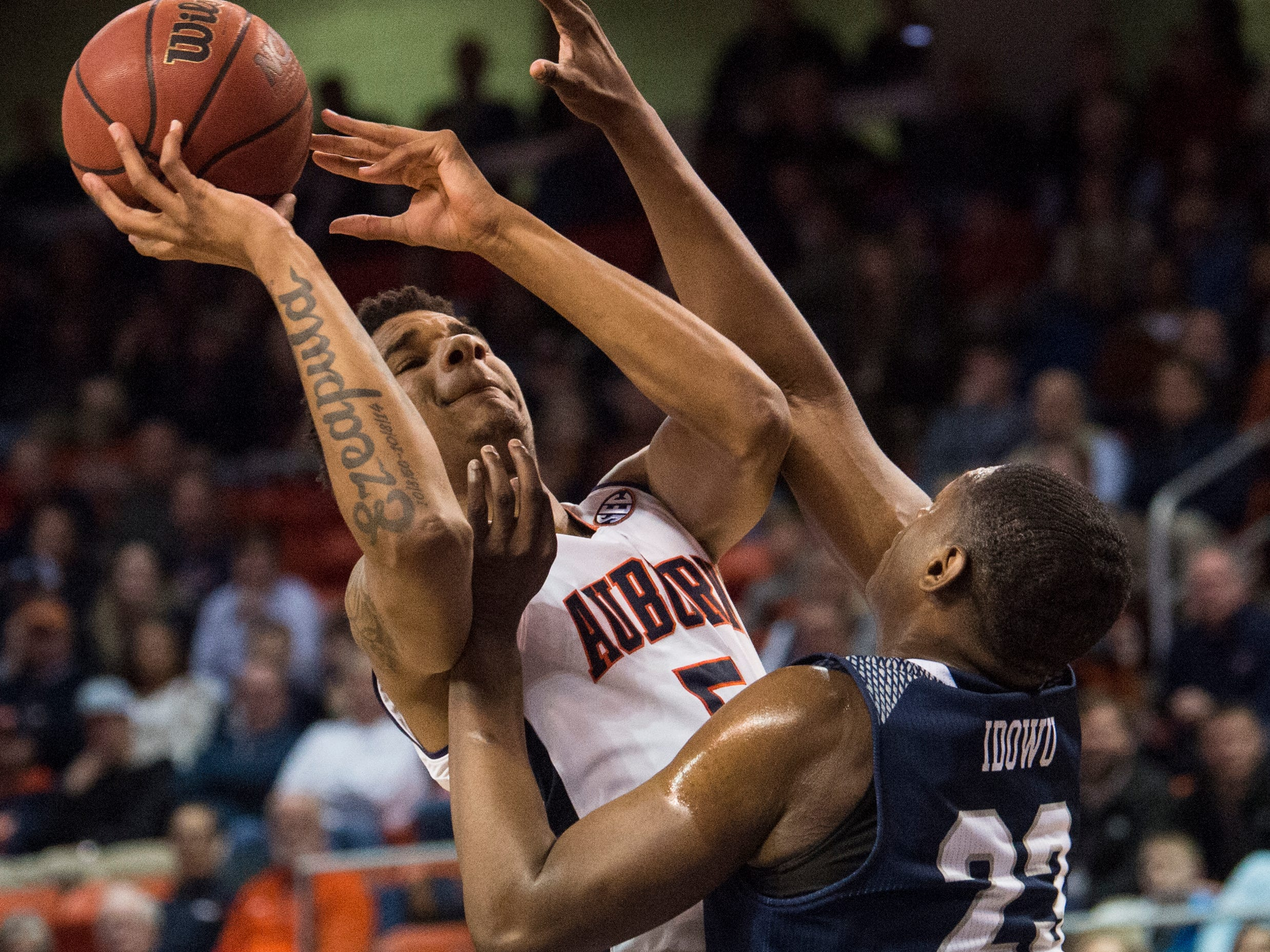 Auburn forward Chuma Okeke (5) goes up for a layup over Saint Peter's forward Samuel Idowu (23) at Auburn Arena in Auburn, Ala., on Wednesday, Nov. 28, 2018. Auburn defeated Saint Peter's 99-49.