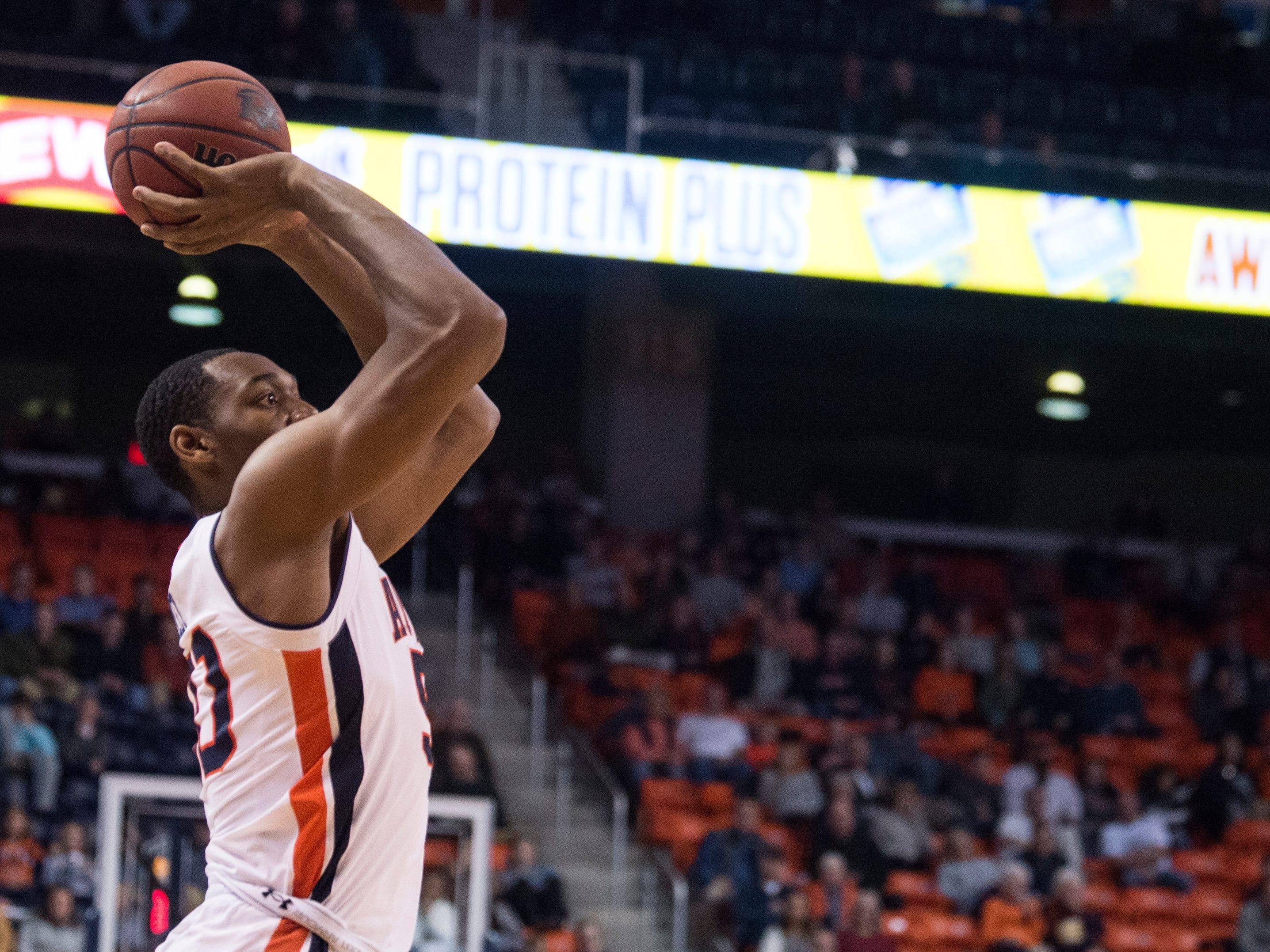 Auburn center Austin Wiley (50) takes a jump shot at Auburn Arena in Auburn, Ala., on Wednesday, Nov. 28, 2018. Auburn defeated Saint Peter's 99-49.