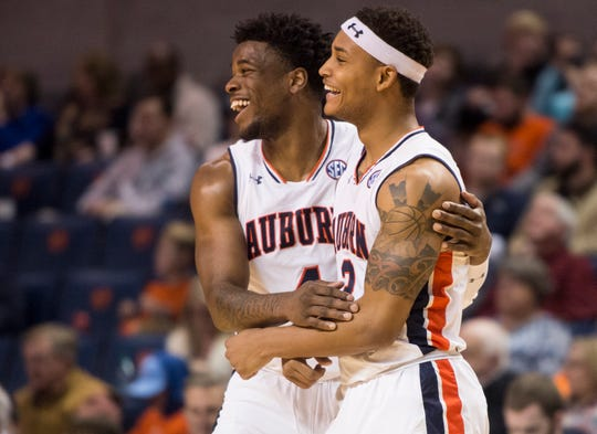 Auburn guard Malik Dunbar (4) and guard Bryce Brown (2) joke around at Auburn Arena in Auburn, Ala., on Wednesday, Nov. 28, 2018. Auburn defeated Saint Peter's 99-49.
