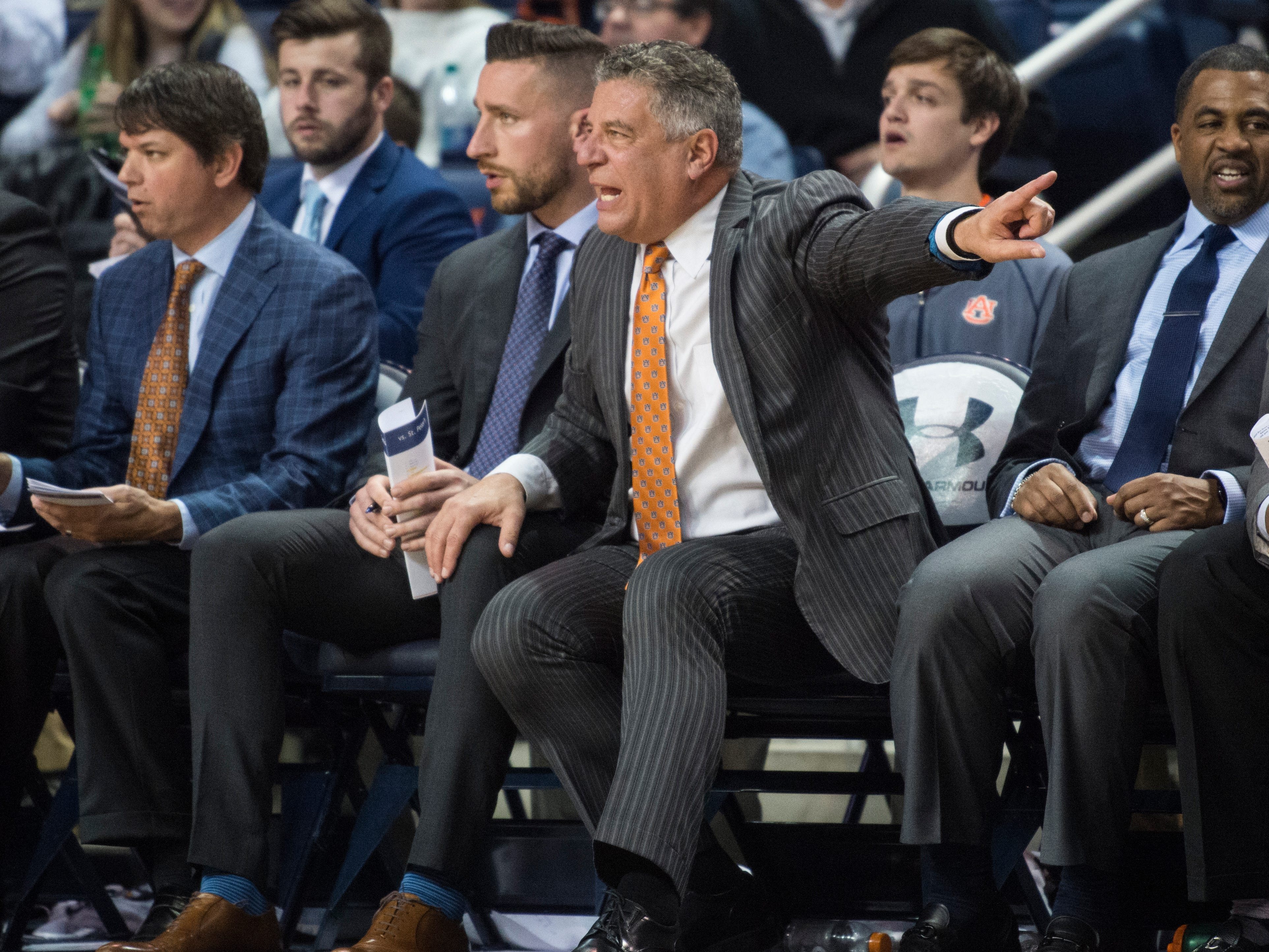 Auburn head coach Bruce Pearl yells at his team from the bench at Auburn Arena in Auburn, Ala., on Wednesday, Nov. 28, 2018. Auburn defeated Saint Peter's 99-49.