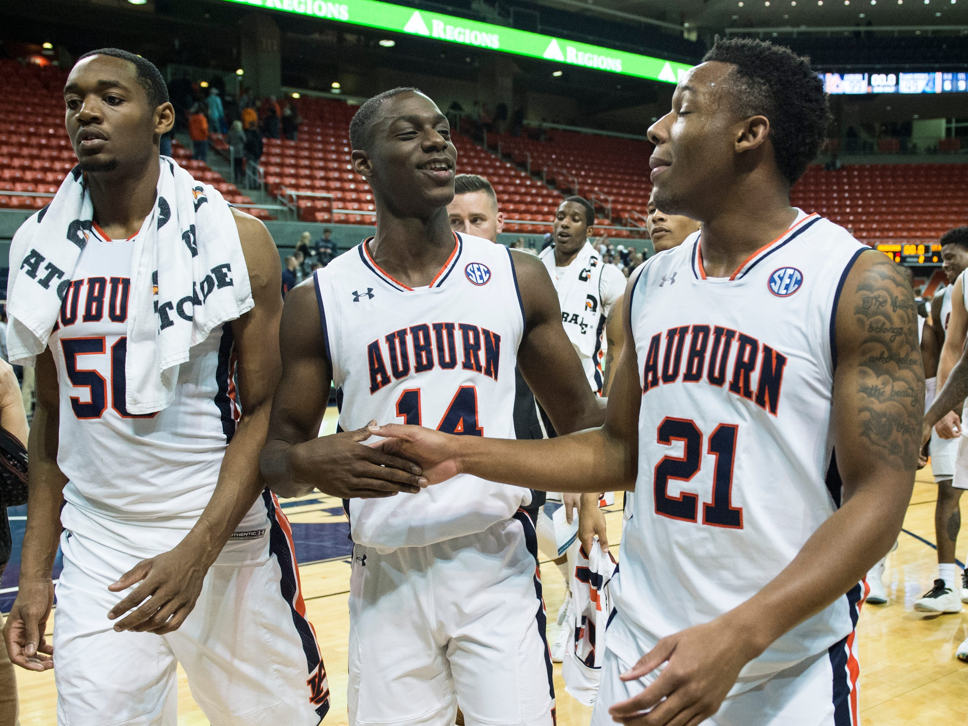 Auburn players walk off the court after the game at Auburn Arena in Auburn, Ala., on Wednesday, Nov. 28, 2018. Auburn defeated Saint Peter's 99-49.
