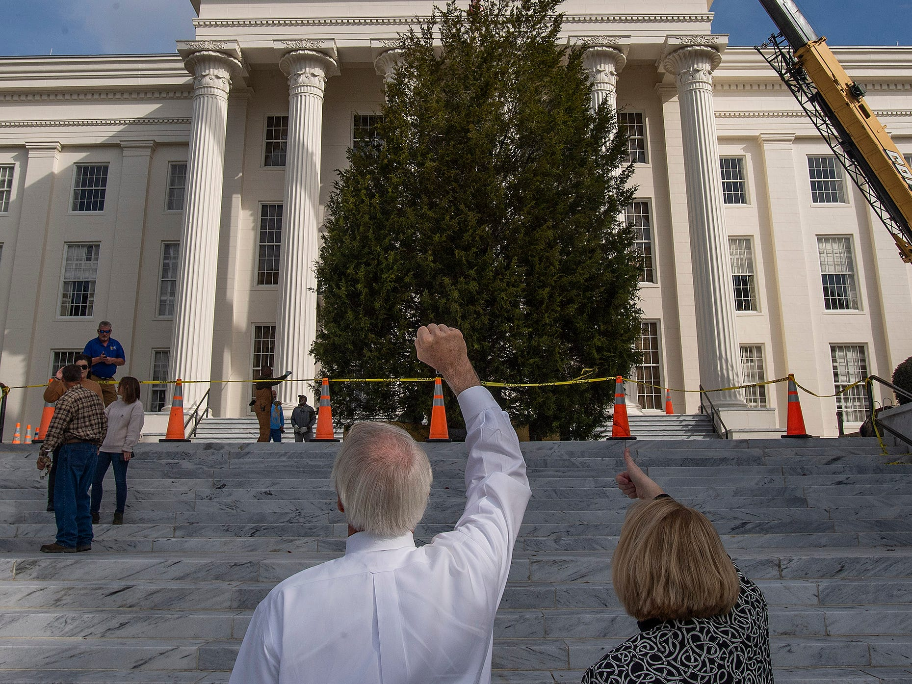 The State Capitol Christmas Tree is directed into place on the state capitol steps in Montgomery, Ala., on Thursday November 29, 2018. The tree will be decorated next week and the Tree Lighting will be held on Friday December 7.