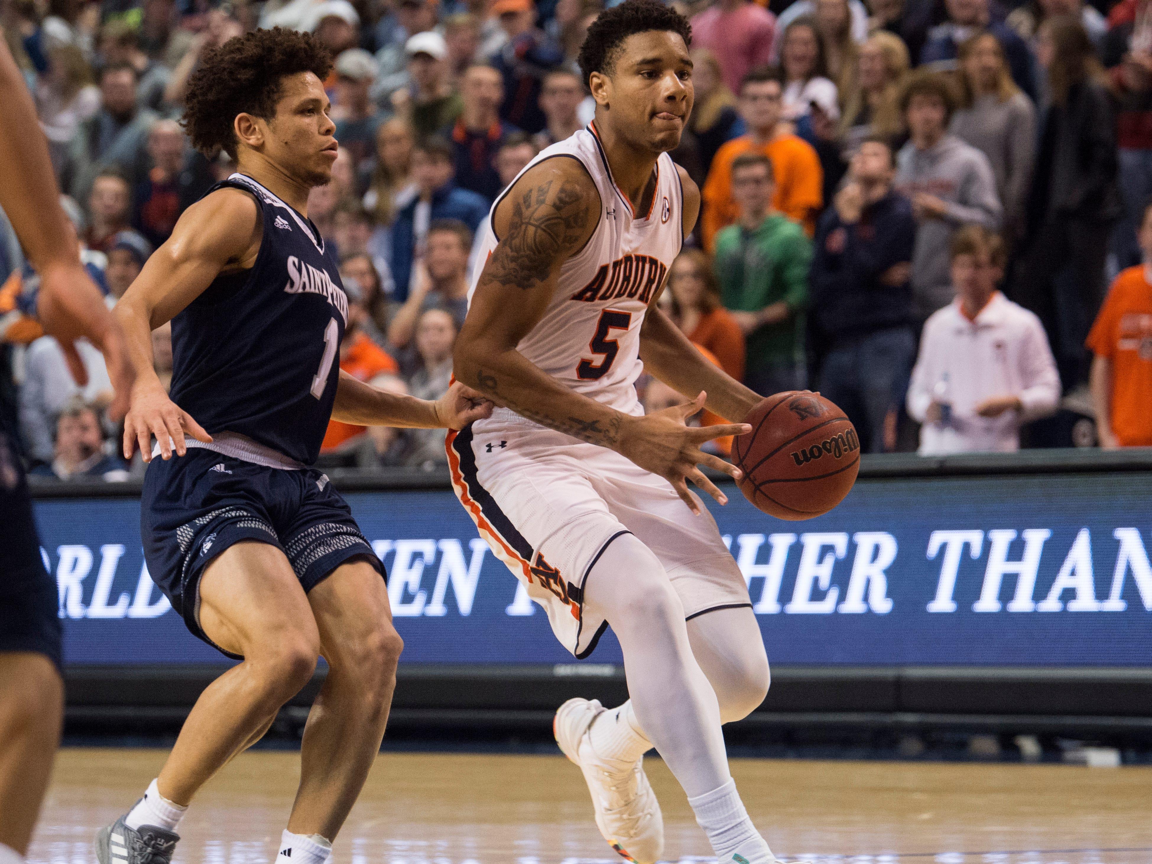Auburn forward Chuma Okeke (5) drives to the basket at Auburn Arena in Auburn, Ala., on Wednesday, Nov. 28, 2018. Auburn defeated Saint Peter's 99-49.
