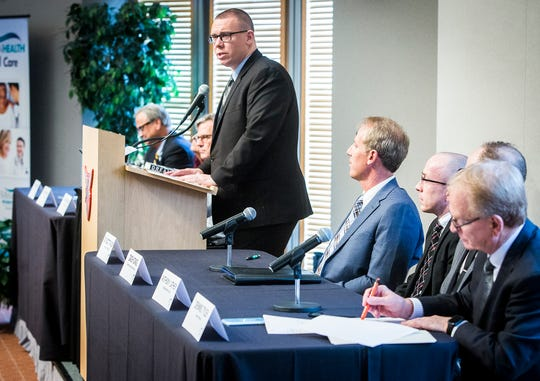 Moderator Greg Fallon, executive editor of The Star Press, introduces panelists during the Meridian Community Health Speaker Series discussion on the opiate crisis at the Ball State Alumni Center Thursday, Nov. 29, 2018.