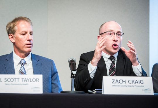 Delaware County deputy prosecutor Zach Craig speaks about the justice system being overwhelmed by drug-related cases during the Meridian Community Health Speaker Series discussion on the opiate crisis at the Ball State Alumni Center Thursday, Nov. 29, 2018.