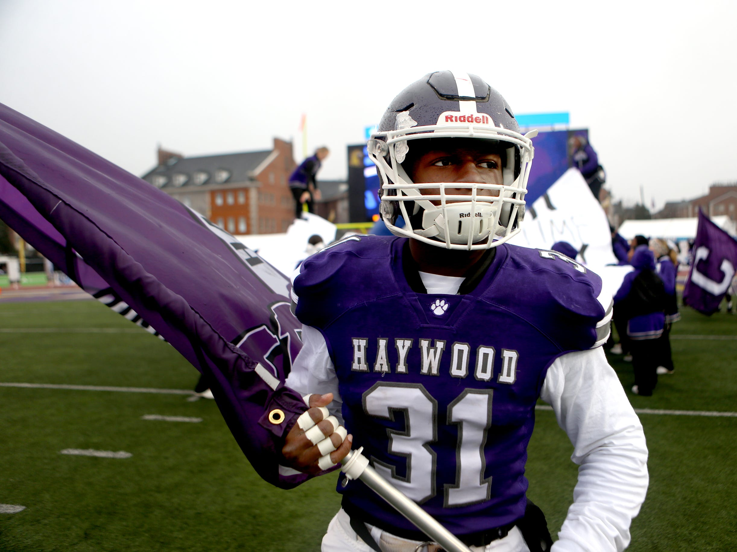 Haywood's  Decourtney Reed (31) holds a Haywood flag as the team runs onto the field during the Class 4A BlueCross Bowl state championship Thursday, Nov. 29, 2018, at Tennessee Tech's Tucker Stadium in Cookeville, Tenn.