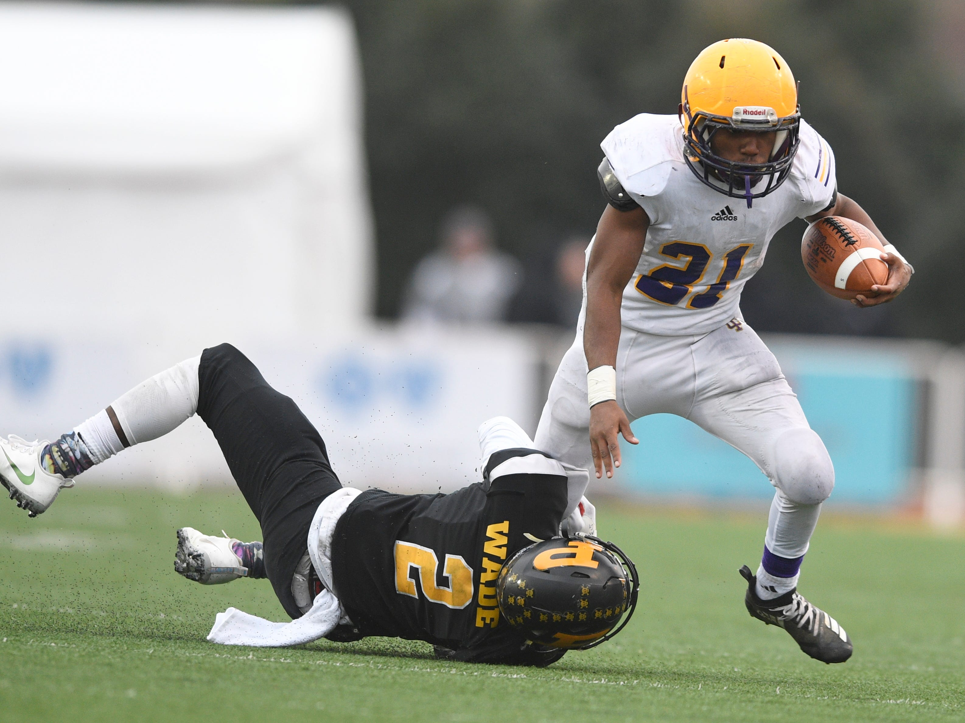 Peabody's Courtlen Wade (2) stops Trousdale's Dyson Satterfield (21) in the third quarter during the Class 2A BlueCross Bowl state championship at Tennessee Tech's Tucker Stadium in Cookeville, Tenn., on Thursday, Nov. 29, 2018.