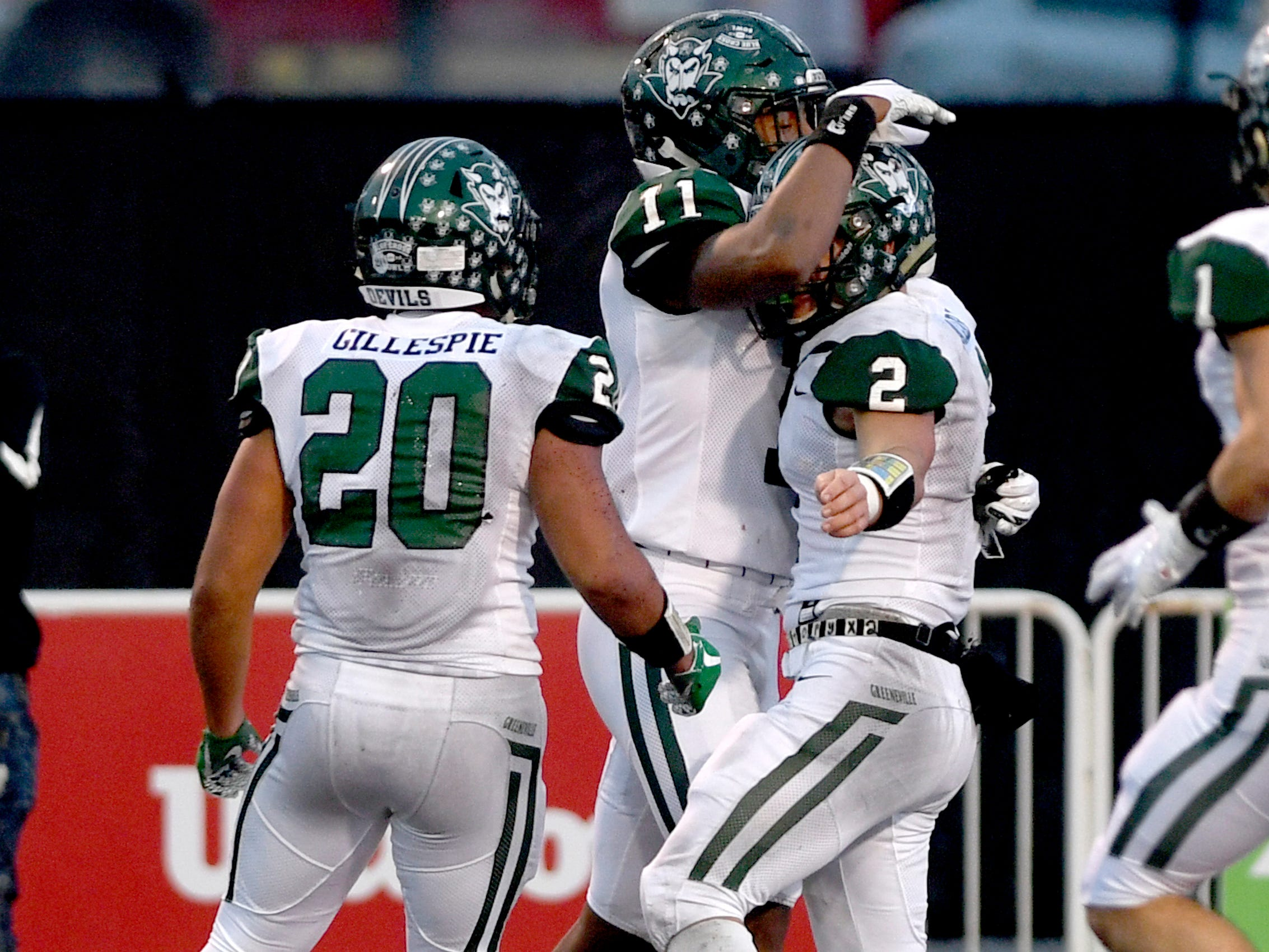 Greeneville's Jaevon Gillespie (20), Greeneville's Dorien Goddard (11) and  Greeneville's Cade Ballard (2) celebrate a touchdown made by Greeneville's Cade Ballard (2)  during the Class 4A BlueCross Bowl state championship game against Haywood Thursday, Nov. 29, 2018, at Tennessee Tech's Tucker Stadium in Cookeville, Tenn.