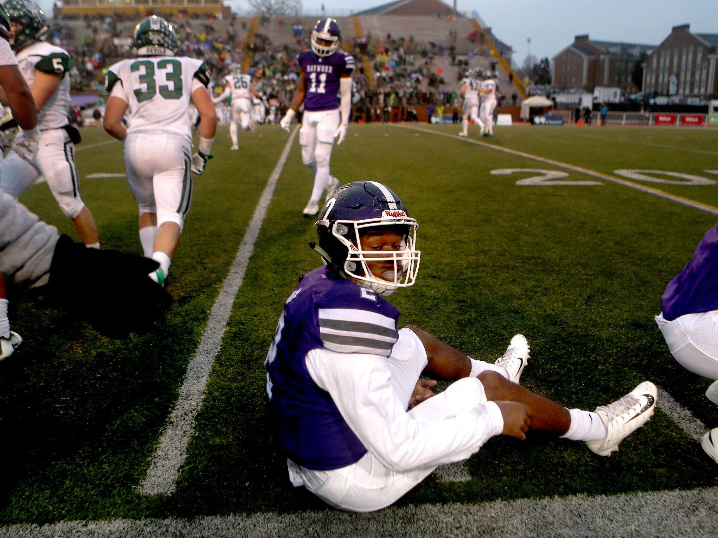 Haywood's Deyondrius Hines (2) sits on the ground after fumbling the ball that was recovered by Greeneville's Logan Shipley (55) during the Class 4A BlueCross Bowl state championship Thursday, Nov. 29, 2018, at Tennessee Tech's Tucker Stadium in Cookeville, Tenn.