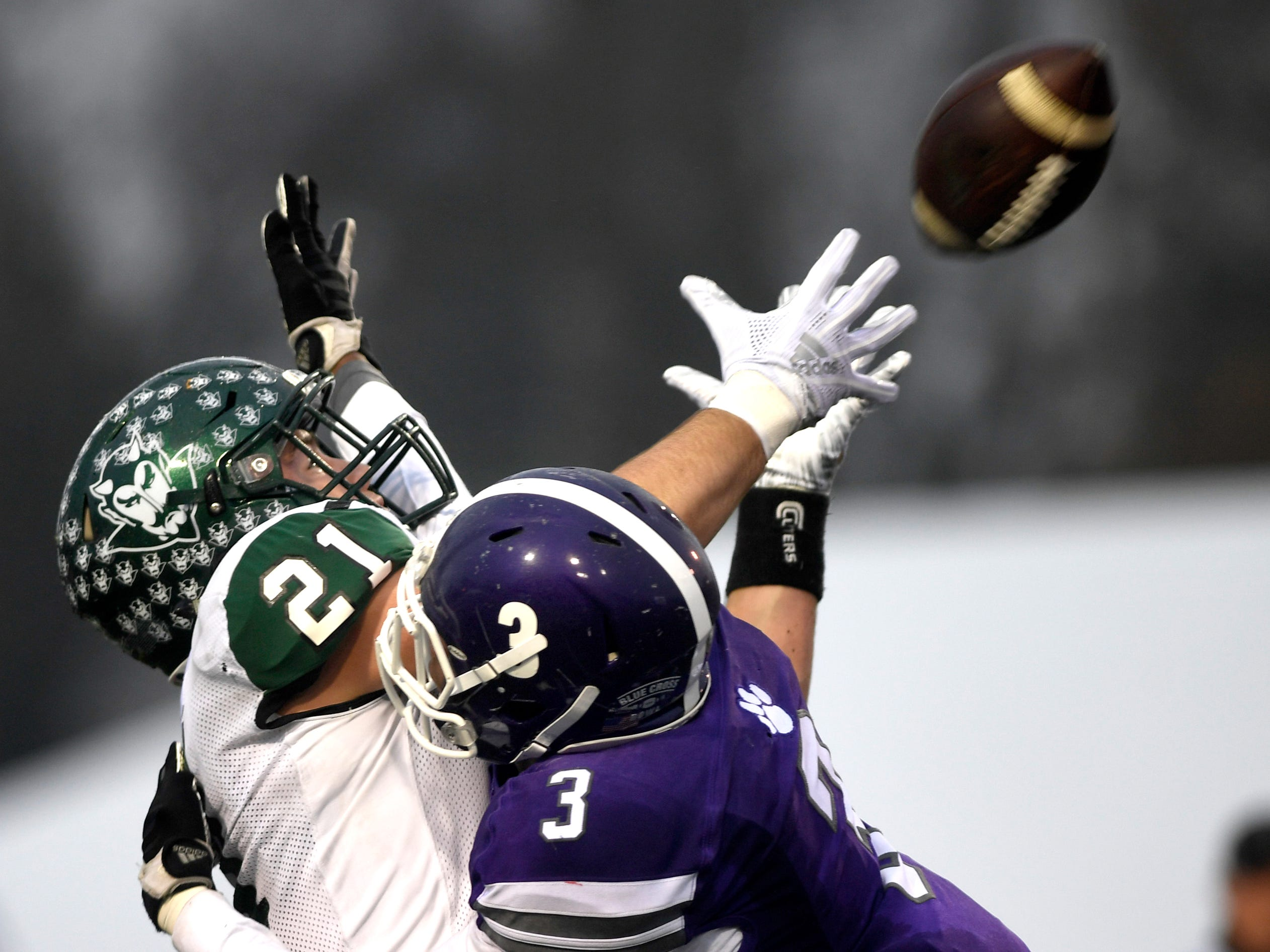 Greeneville's Cameron Hite (21) attempts to make a catch as Haywood's Marquis Pugh (3) covers Hite during the Class 4A BlueCross Bowl state championship Thursday, Nov. 29, 2018, at Tennessee Tech's Tucker Stadium in Cookeville, Tenn.