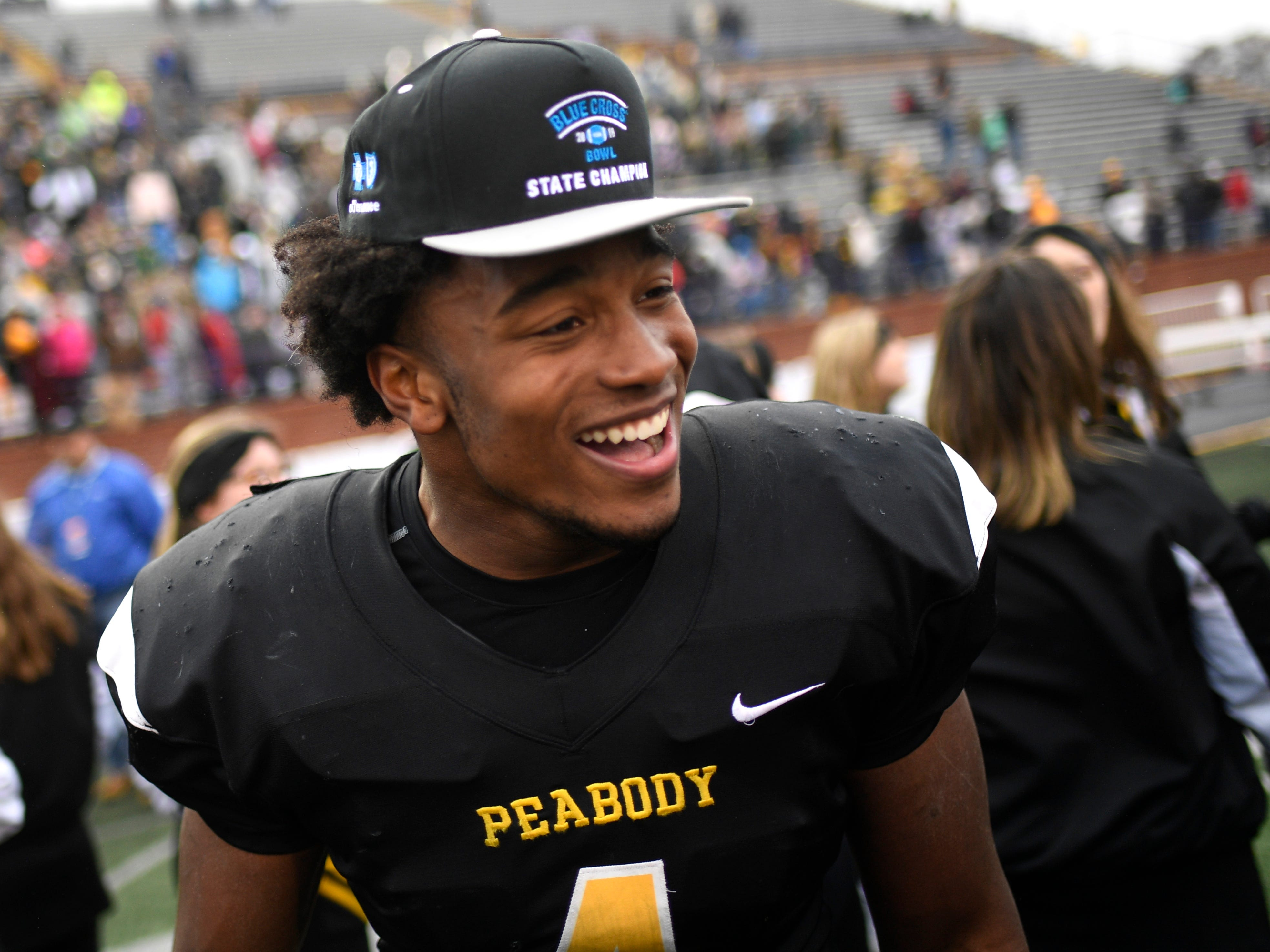 Peabody's Jarel Dickson (4) celebrates the team's 17-9 win over Trousdale in the Class 2A BlueCross Bowl state championship at Tennessee Tech's Tucker Stadium in Cookeville, Tenn., on Thursday, Nov. 29, 2018.