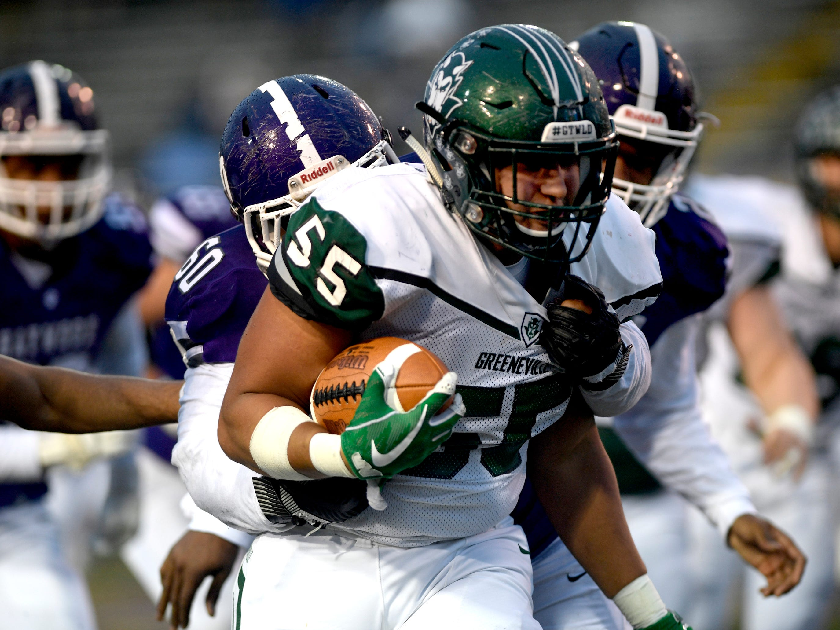Greeneville's Logan Shipley (55) runs the ball after recovering a fumble made by Haywood's Deyondrius Hines (2) during the Class 4A BlueCross Bowl state championship Thursday, Nov. 29, 2018, at Tennessee Tech's Tucker Stadium in Cookeville, Tenn.