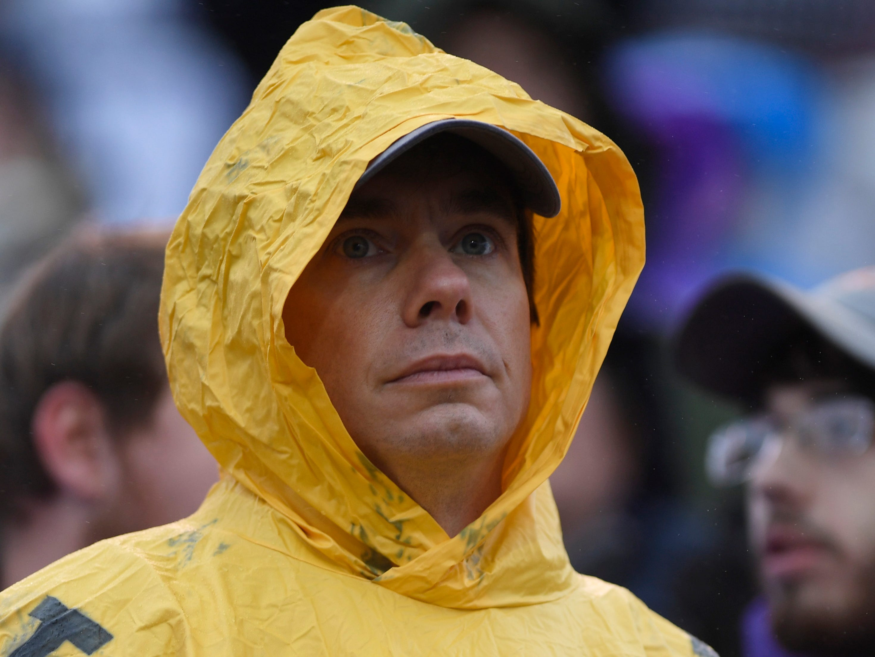 A fan is prepared for the weather during the Class 4A BlueCross Bowl state championship at Tennessee Tech's Tucker Stadium in Cookeville, Tenn., on Thursday, Nov. 29, 2018.