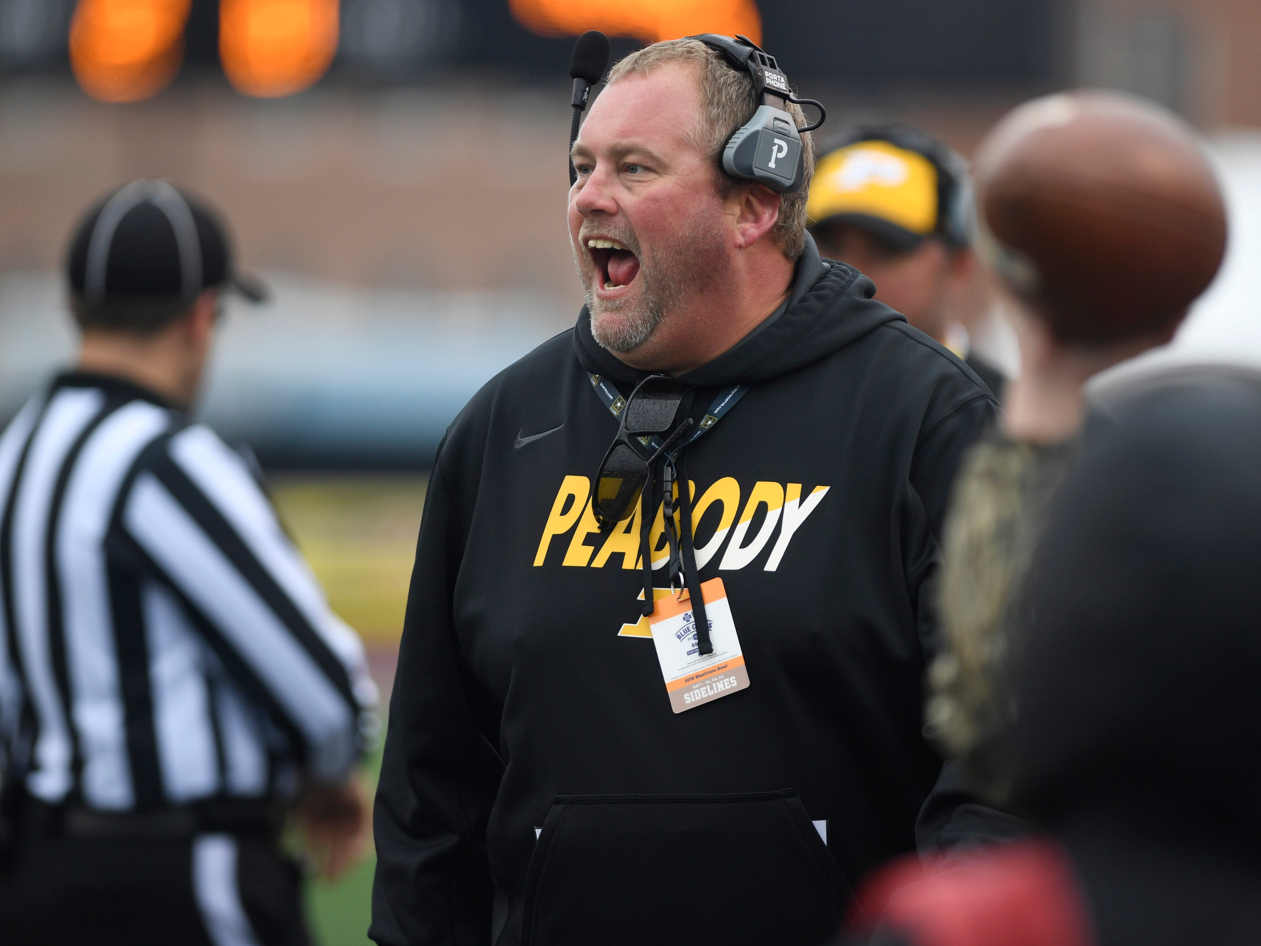 Peabody assistant coach Steve Mathis celebrates a play in the second quarter during the Class 2A BlueCross Bowl state championship at Tennessee Tech's Tucker Stadium in Cookeville, Tenn., on Thursday, Nov. 29, 2018.
