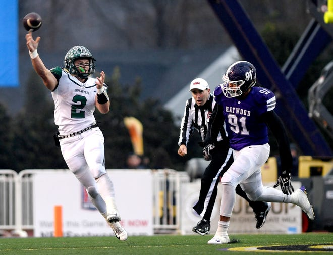 Greeneville's quarterback Cade Ballard (2) throws a pass as Haywood's  Jewin Young (91) moves in for a tackle during the Class 4A BlueCross Bowl state championship Thursday, Nov. 29, 2018, at Tennessee Tech's Tucker Stadium in Cookeville, Tenn.