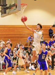 Jacket's #1 Trent Turner jumps high to score 2 helping  the Jackets defeat Page in their 1st home game of the 2018-2019 Season.