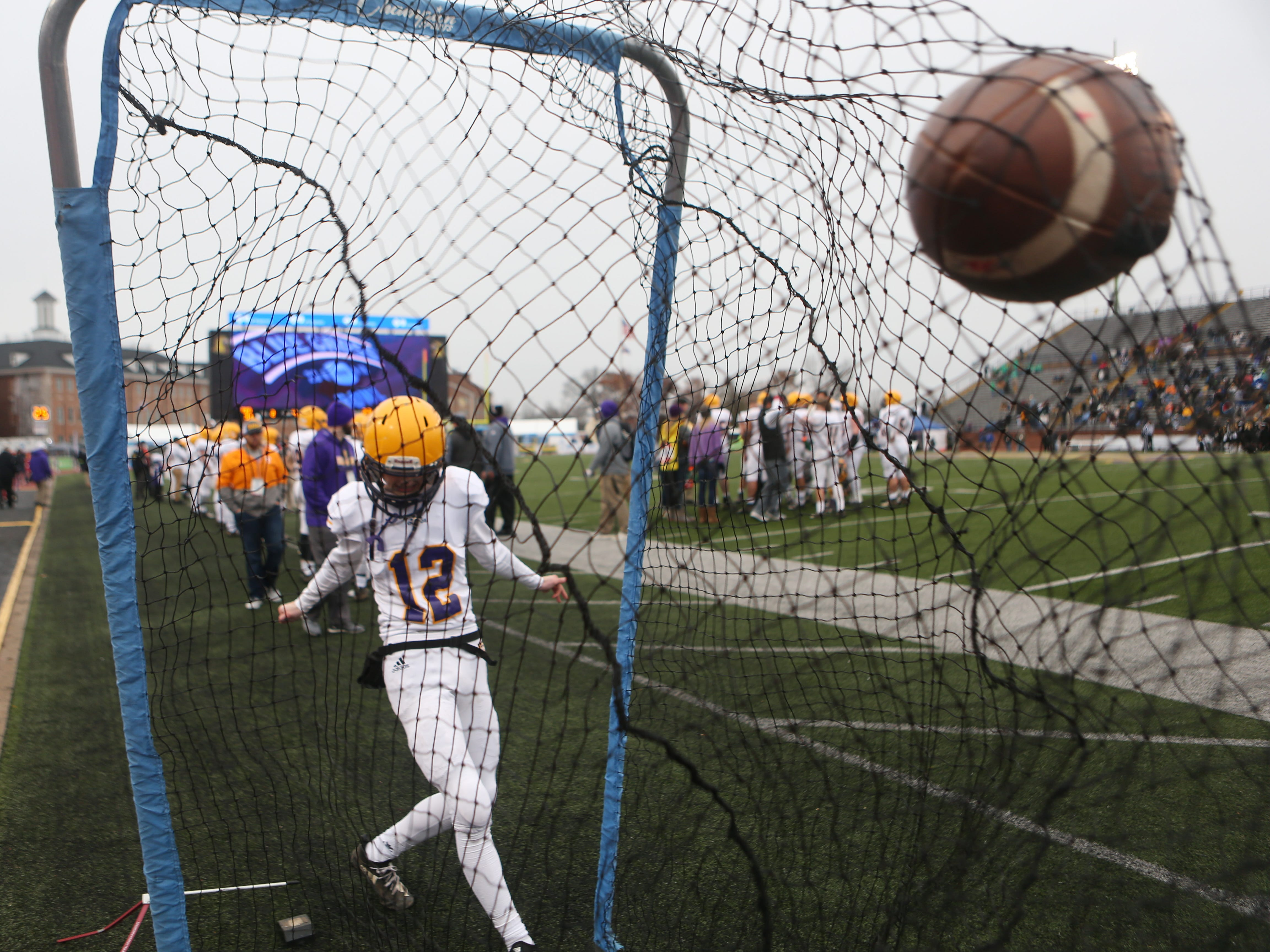Trousdale's Heath Chasse (12) gets in some kicks along the sideline during the Class 2A BlueCross Bowl state championship at Tennessee Tech's Tucker Stadium in Cookeville, Tenn., on Thursday, Nov. 29, 2018.