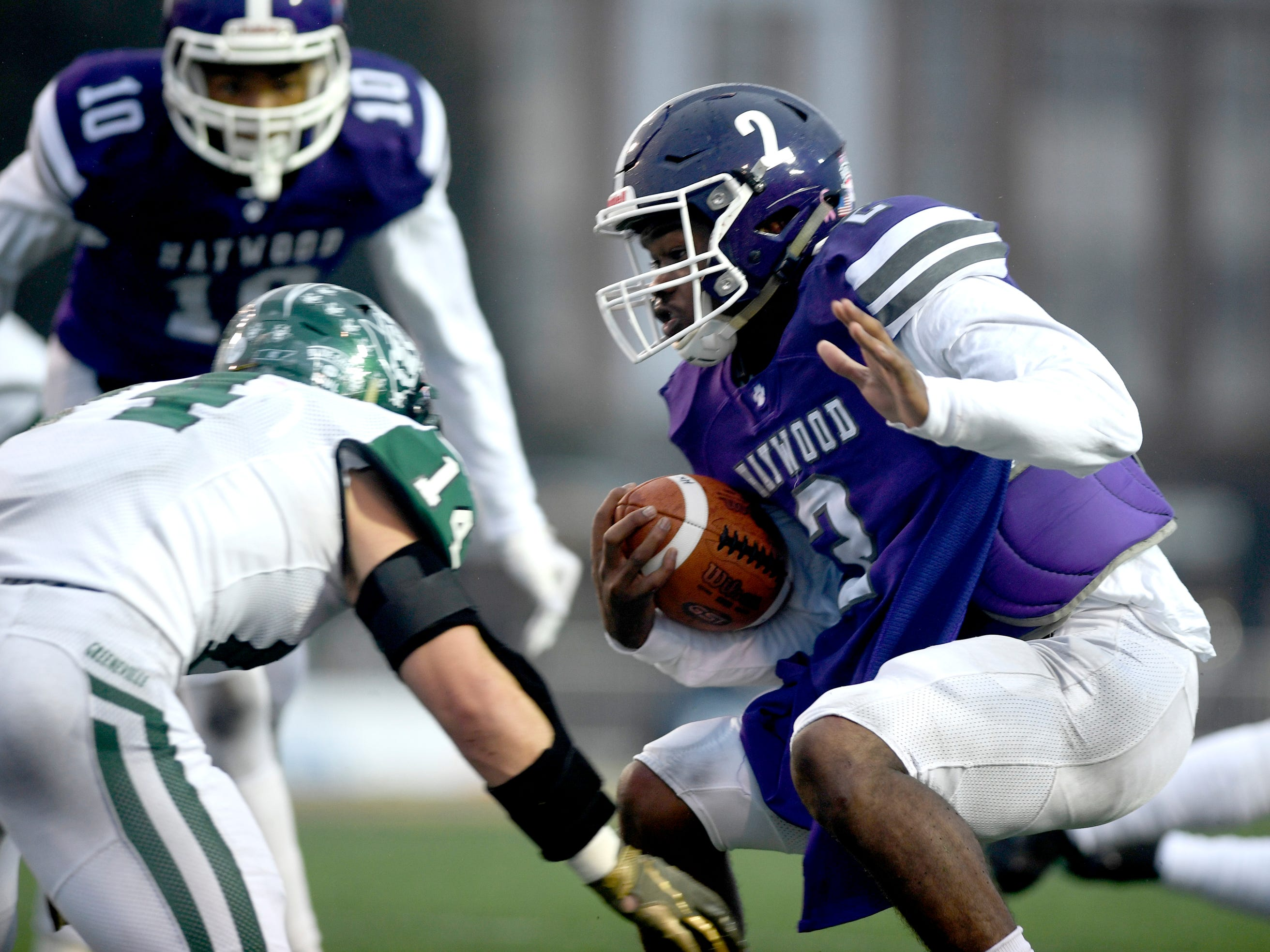 Haywood's  Deyondrius Hines (2) runs the ball as Greeneville's Dalton McLain (14) moves in for a tackle during the Class 4A BlueCross Bowl state championship Thursday, Nov. 29, 2018, at Tennessee Tech's Tucker Stadium in Cookeville, Tenn.