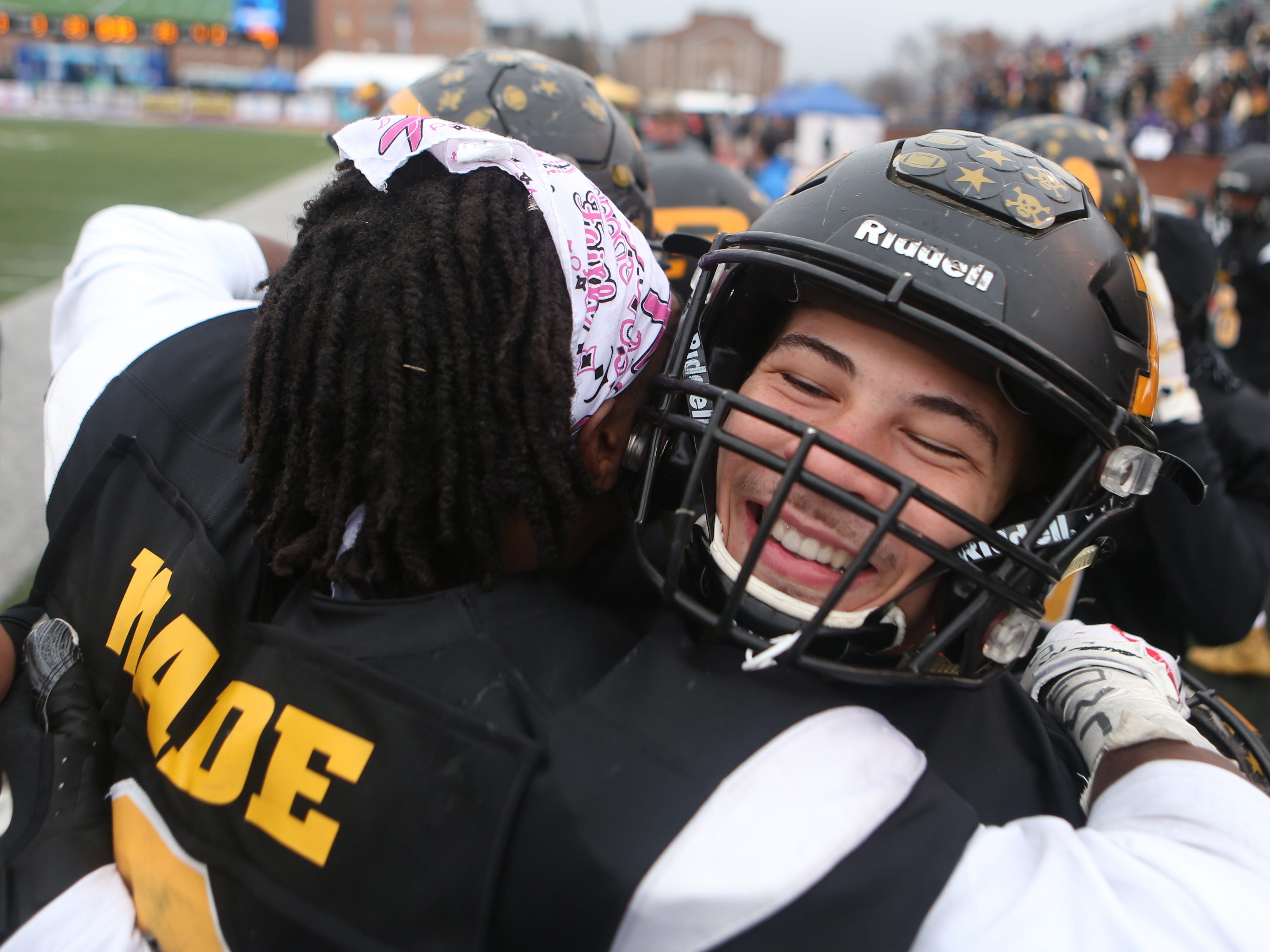 Peabody's Qua Parks (10) and Courtlen Wade (2) celebrate after the team's win in the Class 2A BlueCross Bowl state championship at Tennessee Tech's Tucker Stadium in Cookeville, Tenn., on Thursday, Nov. 29, 2018.