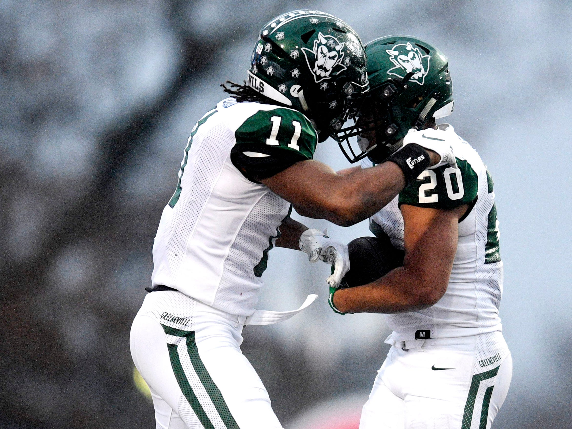 Greeneville's Jaevon Gillespie (20) celebrates his touhdown with Greeneville's Dorien Goddard (11) in the first half of the Class 4A BlueCross Bowl state championship at Tennessee Tech's Tucker Stadium in Cookeville, Tenn., on Thursday, Nov. 29, 2018.