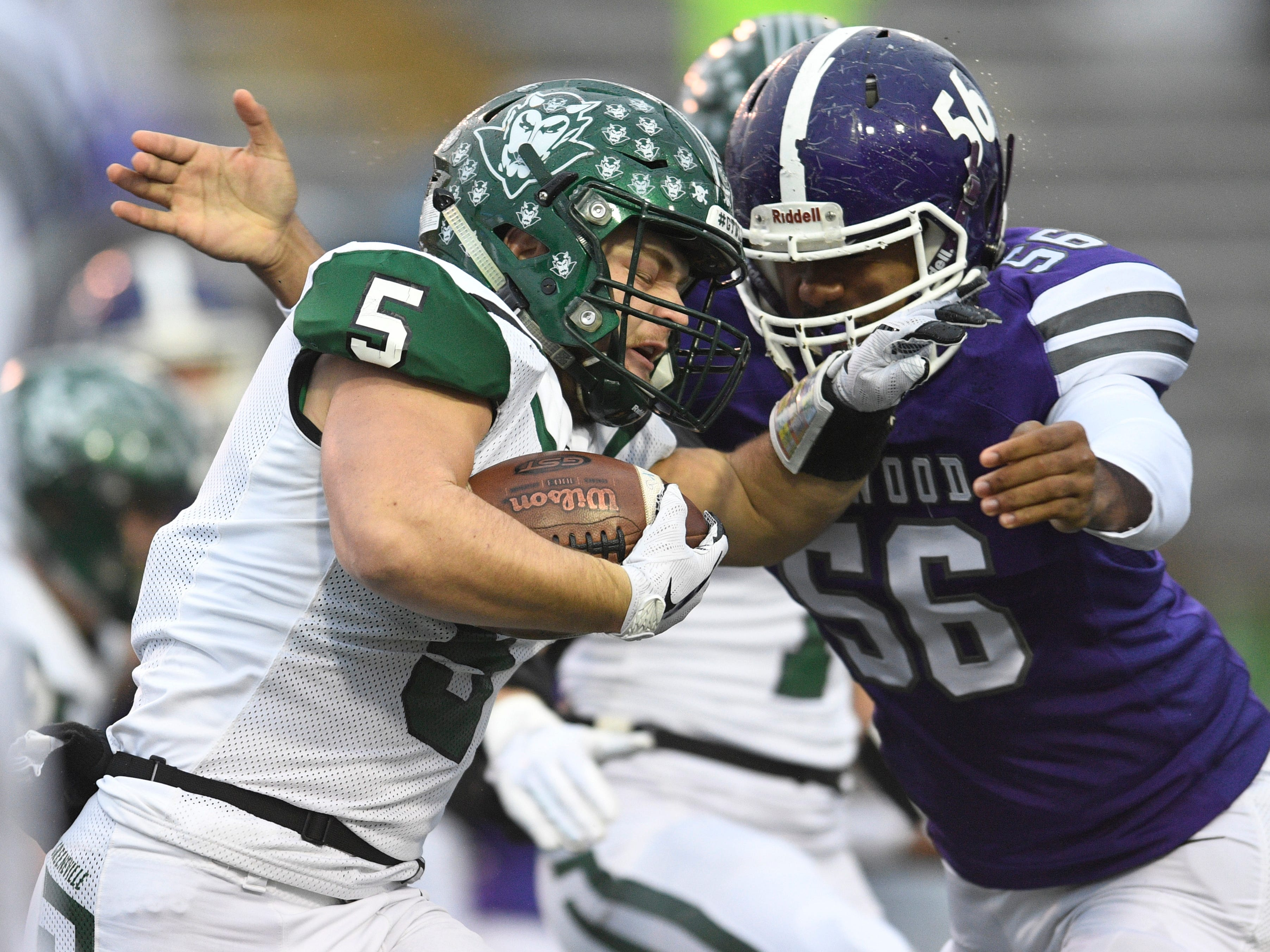 Haywood's  Iverson Hines (56) closes in on Greeneville's Garrin Shuffler (5) in the first quarter during the Class 4A BlueCross Bowl state championship at Tennessee Tech's Tucker Stadium in Cookeville, Tenn., on Thursday, Nov. 29, 2018.