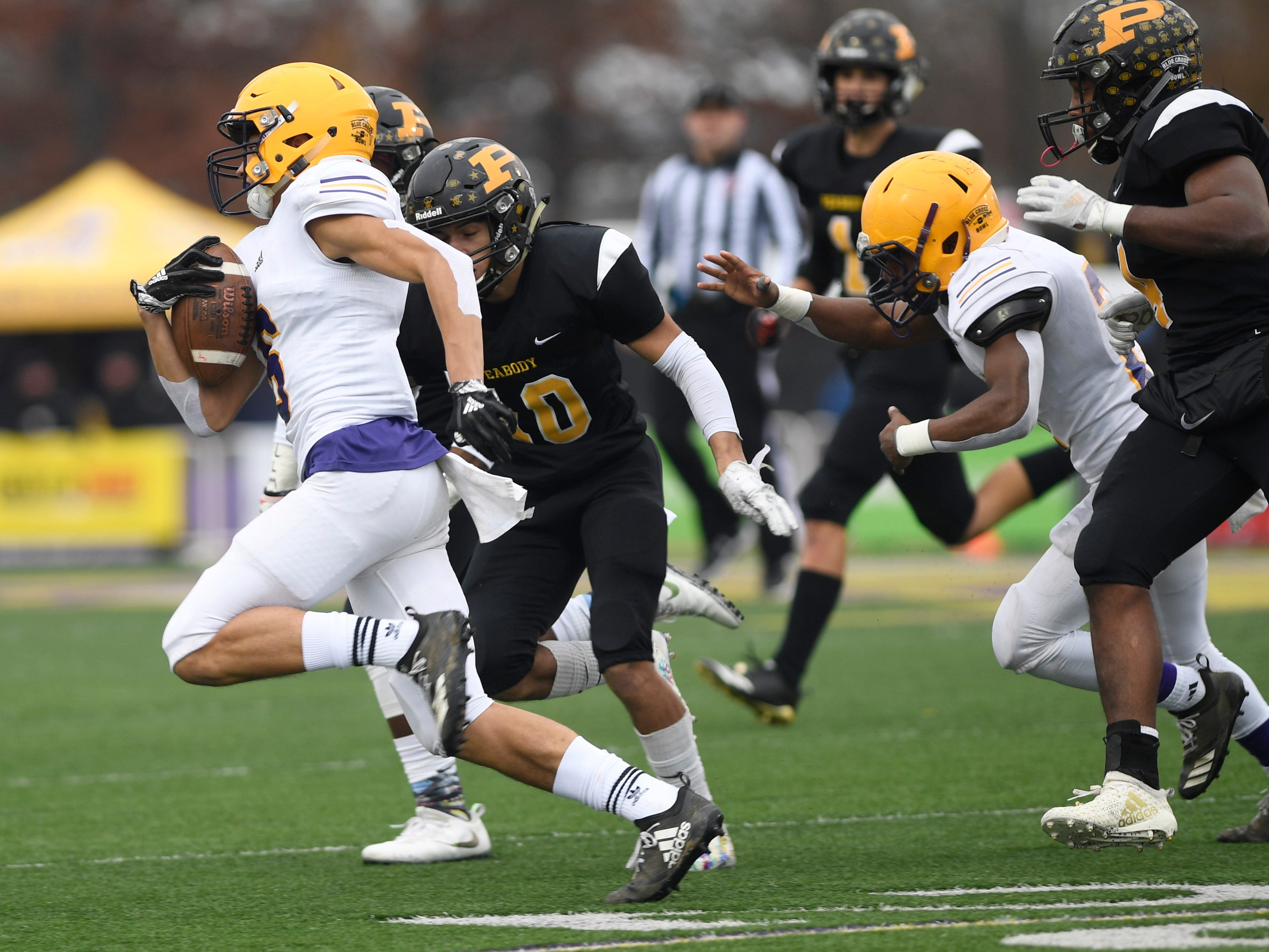 Trousdale's Jayden Hicks (6) takes off on a run in the second quarter during the Class 2A BlueCross Bowl state championship at Tennessee Tech's Tucker Stadium in Cookeville, Tenn., on Thursday, Nov. 29, 2018.