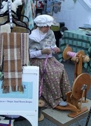 Melody Weist of Double Creek Farm in Lebanon demonstrates yarn spinning on a Majacraft Susie spinning wheel at last year's Dickens of a Christmas