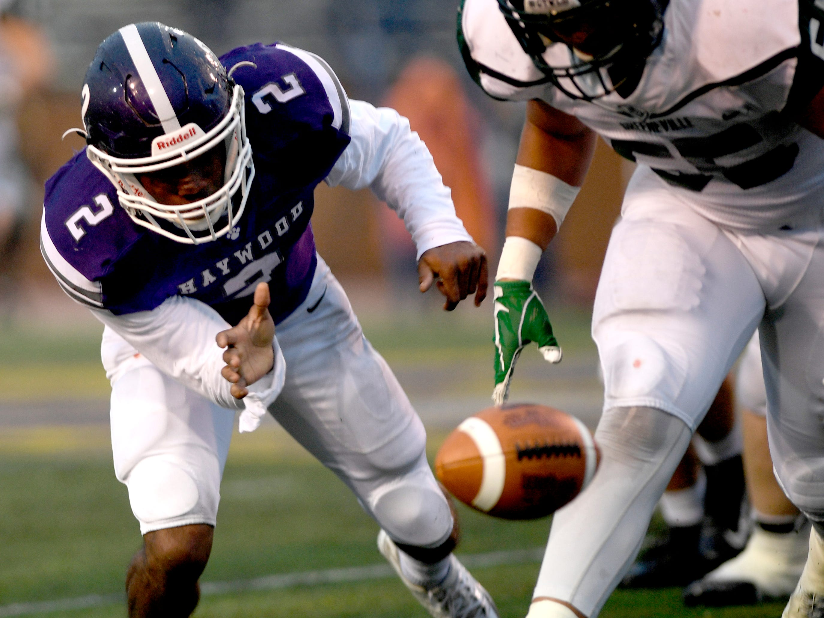 Haywood's  Deyondrius Hines (2) fumbles the ball as Greeneville's Logan Shipley (55) moves in to recover the ball during the Class 4A BlueCross Bowl state championship Thursday, Nov. 29, 2018, at Tennessee Tech's Tucker Stadium in Cookeville, Tenn.