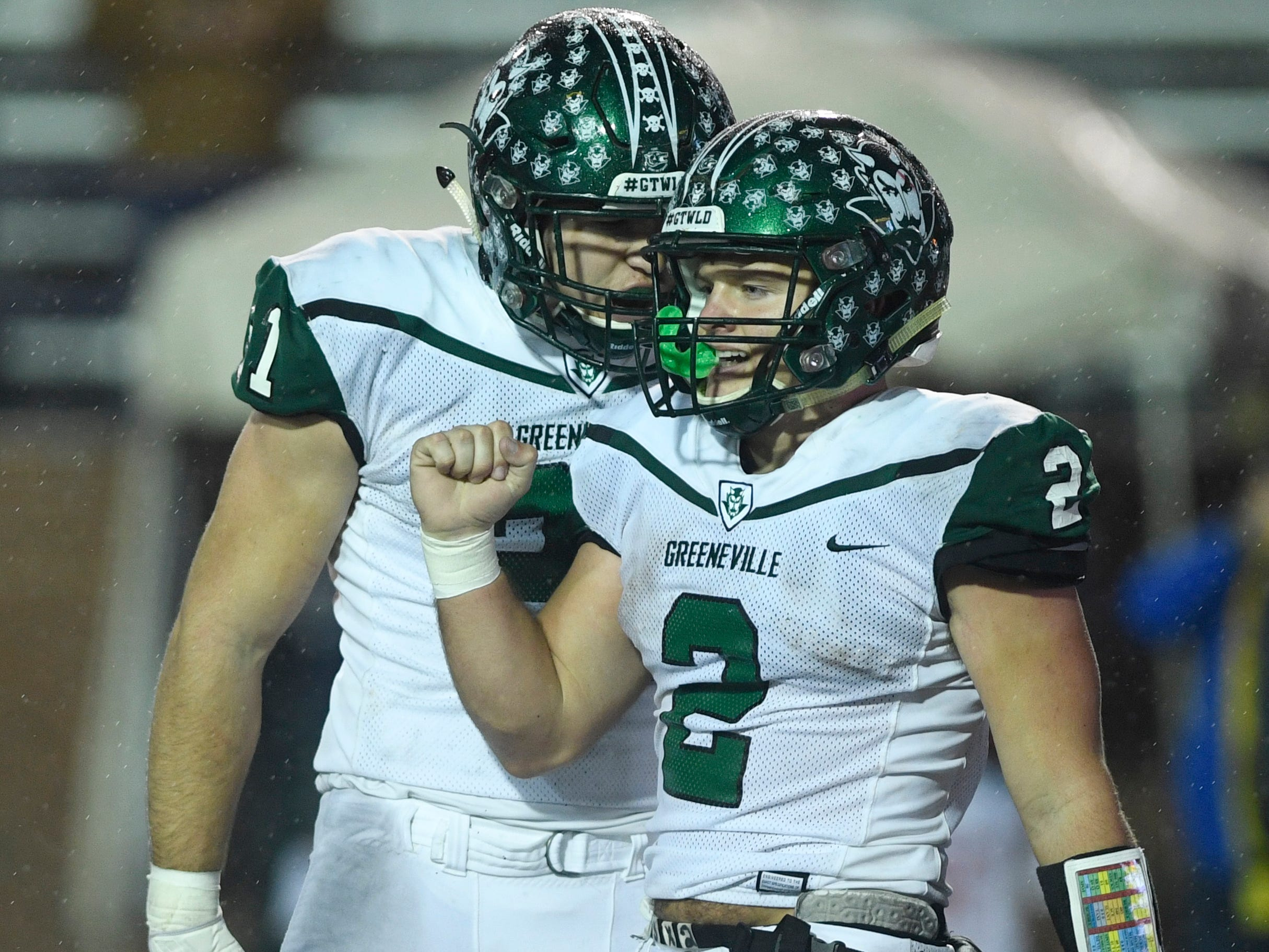 Greeneville's Cameron Hite (21) yells at Cade Ballard (2) after Ballard scored a touchdown in the second half of the Class 4A BlueCross Bowl state championship at Tennessee Tech's Tucker Stadium in Cookeville, Tenn., on Thursday, Nov. 29, 2018.