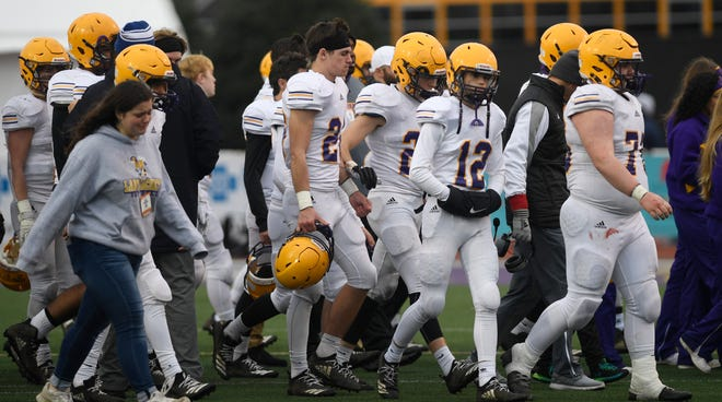 Trousdale County players walk off the field after losing to Peabody on Thursday in the Class 2A BlueCross Bowl at Tennessee Tech's Tucker Stadium.