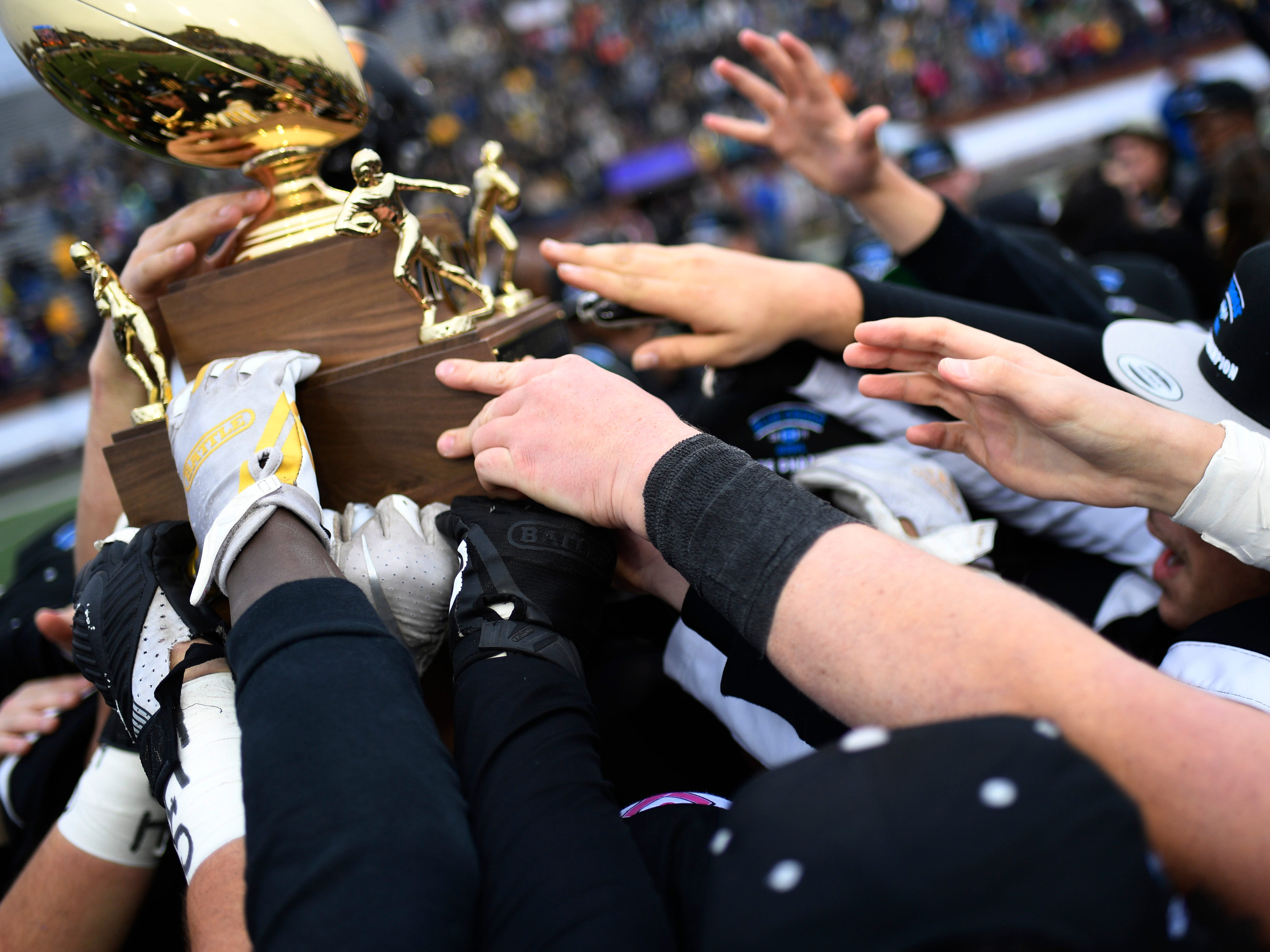 Peabody players celebrate the team's Class 2A BlueCross Bowl state championship at Tennessee Tech's Tucker Stadium in Cookeville, Tenn., on Thursday, Nov. 29, 2018.