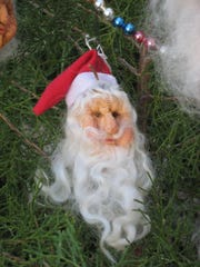"""Santa heads"" made from dried apples are popular ornaments."