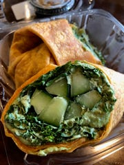 "The Nashville Hot Kale Wrap is loaded with kale and fresh cucumber, with a spicy ""dragon"" sauce sealed up in a chili tortilla."